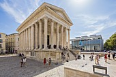France, Gard, Nimes, Maison Carree, old Roman Temple of the 1st century BC, Contemporary Art museum, view of Le Carré d'Art of the architect Norman Foster, the media library, the Contemporary Arts Center and his restaurant on the high terrace