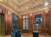 France, Paris, area listed as World Heritage by UNESCO, Louvre museum, egyptian antiquities department, Vincennes room, wood works of the council room in the Queen pavilion of the Château Neuf of Vincennes built in 1654. Statue of the egyptian god Amon protecting king Tutankhamun carved between 1336 an 1327 B.C. and portrait of Louis XIII by Philippe de Champaigne
