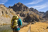 France, Alpes-Maritimes, Mercantour National Park, Gordolasque Valley, hiker walking by lake Autier (2275m)