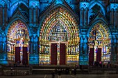 France, Somme, Amiens, Notre-Dame cathedral, jewel of the Gothic art, listed as World Heritage by UNESCO, gate of the western facade, polychrome sound and light show presenting the original polychromy of the facades