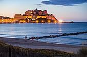 France, Haute-Corse, Balagne, Calvi and his Genoese citadel seen since the beach of the bay of Calvi