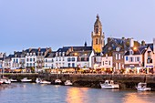 France, Loire Atlantique, Guerande peninsula, Le Croisic, the docks and 15th and 16th centuries Notre Dame de Pitie church, Flamboyant Gothic style, at dusk