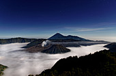 Fog cover over the Great Sand Sea, Bromo volcano and Semeru in the background, Java Island, Indonesia, Southeast Asia, Asia