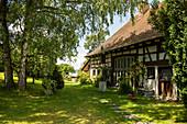 Half-timbered house with cottage garden, Seefelden, Uhldingen, Lake Constance, Baden-Württemberg, Germany