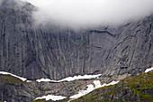 Rock wall in front of Nusfjord, Flakstadoeya, Lofoten, Nordland, Norway, Europe