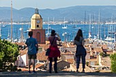 "France, Var, Saint-Tropez, parochial church Notre-Dame of the Assumption and the traditional yachts on the occasion of the "" Voiles de Saint-Tropez"""