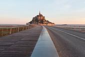 France, Manche, Mont Saint Michel bay listed as World Heritage by UNESCO, the pedestrian footbridge by architect Dietmar Feichtinger and Mont Saint Michel
