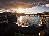 France, Paris, Paris, area listed as World Heritage by UNESCO, Sunset over the Seine river from the Alexander 3 bridge