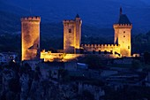 France, Ariege, Foix, Contal castle of Gaston Febus and counts of Foix overlooking the city, illuminations at nightfall