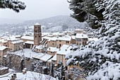 France, Alpes de Haute Provence, regional natural reserve of Verdon, Moustiers Sainte Marie, certified the Most beautiful Villages of France, the village and the Notre Dame de l'Assomption church during a snowfall