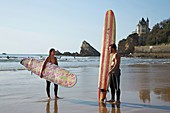 France, Pyrenees Atlantiques, Pays Basque, Biarritz, couple of surfers on the beach of the Basques coast beach