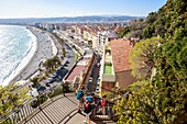 France, Alpes Maritimes, Nice, the Baie des Anges, the beach of Ponchettes and the Quai des Etats Unis and street of Ponchettes from the stairs of the montée Lesage