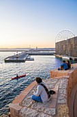 France, Bouches du Rhone, Marseille, sunset on the ramparts of Fort Saint Jean with the Mucem
