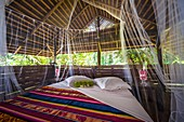 France, French Guiana, Kourou, resting hut with kingsize bed and mosquito net, Wapa Lodge
