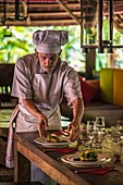 France, French Guiana, Kourou, Chef preparing a gourmet lunch at the Wapa Lodge without running water or electricity