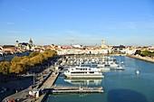 France, Charente Maritime, La Rochelle, the old Port, the Great Clock Gate (Porte de la Grosse Horloge), the Saint Louis cathedral and St Sauveur church