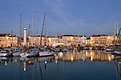 France, Charente-Maritime, La Rochelle, the wet dock of the Old Port and its lighthouse