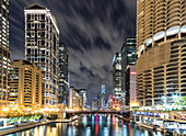 Downtown Chicago at night,The Loop and the river,buildings lit up.