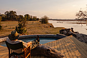 Traveller relaxing at Kalamu Tented Camp,South Luangwa National Park,Zambia