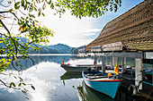 Boats moored at boat house,Kandy Lake (Kiri Muhuda or Sea of Milk),artificial lake in heart of hill city,Kandy,Sri Lanka