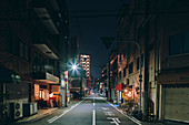 Night scene of an empty street,and old retail and apartment block buildings,Osaka,Japan