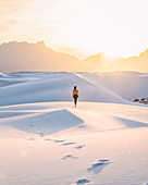 Woman on white sand dunes,White Sands National Monument,New Mexico,US