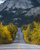 Campervan driving through Icefields Parkway in fall,Alberta,Canada