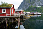 Rorbuer, traditional fishermnen's cottages now used for tourist accommodaton in Reine, Moskenesoya, The Lofoten Islands, Norway, Europe