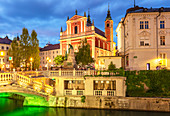 The pink Franciscan Church and the Triple Bridge (Tromostovje) over the Ljubljanica Rriver at night, Ljubljana, Slovenia, Europe