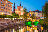 The pink Franciscan Church of the Annunciation, Ljubljanica River and the Triple Bridge at night, Ljubljana, Slovenia, Europe