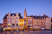 The Grand Place and Lille Chamber of Commerce Belfry at dusk, Lille, Nord, France, Europe