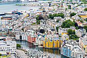 Elevated view of colorful Art Nouveau styled houses along Brosundet canal, Alesund, More og Romsdal county, Norway, Scandinavia, Europe