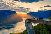 People admiring sunset from Stegastein viewpoint, aerial view, Aurlandsfjord, Sogn og Fjordane county, Norway, Scandinavia, Europe