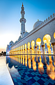 Abu Dhabi's magnificent Grand Mosque lit up during the evening blue hour, Abu Dhabi, United Arab Emirates, Middle East