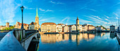 Panoramic of Fraumunster church and Limmat River seen from Munsterbrucke bridge at sunrise, Zurich, Switzerland, Europe