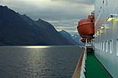 Hurtigruten in the Hjoerundfjorden near Alesund, Moere og Romsdal, Norway, Europe
