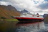 Hurtigruten in the Hjoerundfjorden near Urke, Nahe Alesund, Moere og Romsdal, Norway, Europe