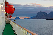 Hurtigruten ship near the island of Bolga in Roedoeyfjorden, Roedoeyfjord, Helgeland coasts, Nordland province, Salten, Norway, Europe