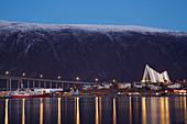 Arctic Cathedral (Ishavskatedralen) and bridge (Bruvegen) over the Tromsöysundet, Tromsö, Schnee, Troms, Norway, Europe