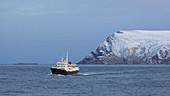 Hurtigruten ship MS Lofoten in front of Havöysund, Hjelmsöya Island, Breisundet, Finnmark Province, Vest-Finnmark, Norway, Europe
