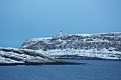 View of Vardö Lighthouse, Hornöya Island, Barents Sea, Finnmark Province, Norway, Europe