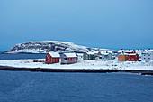 View of Vardö and the Vardö lighthouse, snow, Hornöya island, Vardöya island, Barents Sea, Finnmark Province, Norway, Europe