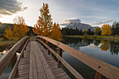 Bridge over Cascade Pond with Mount Rundle on horizon in autumn, Banff National Park, UNESCO World Heritage Site, Alberta, Rocky Mountains, Canada, North America