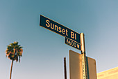 A close up of a road sign pointing to Sunset Boulevard in Los Angeles, California, United States of America, North America