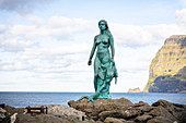 Bronze statue of the seal woman created by Hans Pauli Olsen, based on the folk tale in which the village of Mikladalur was cursed, Mikladalur, Kalsoy, Faroe Islands, Denmark.