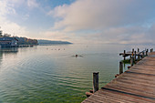 Morning view from the jetty on Lake Starnberg on the beach of Percha, Starnberg, Bavaria, Germany.