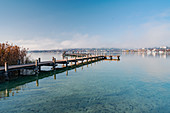 Morning view of the bathing jetty on Lake Starnberg on the bathing beach of Percha, Starnberg, Bavaria, Germany.
