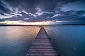 Bathing jetty on the east bank of Lake Starnberg near Pischetsried in the evening light, Münsing, Bavaria, Deutchland