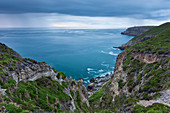 Rain clouds move over the sea and color the water a deep blue. Cap Frehel, Brittany, France