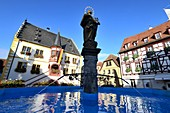 at the market square with town hall in Volkach am Main, Lower Franconia, Bavaria, Germany